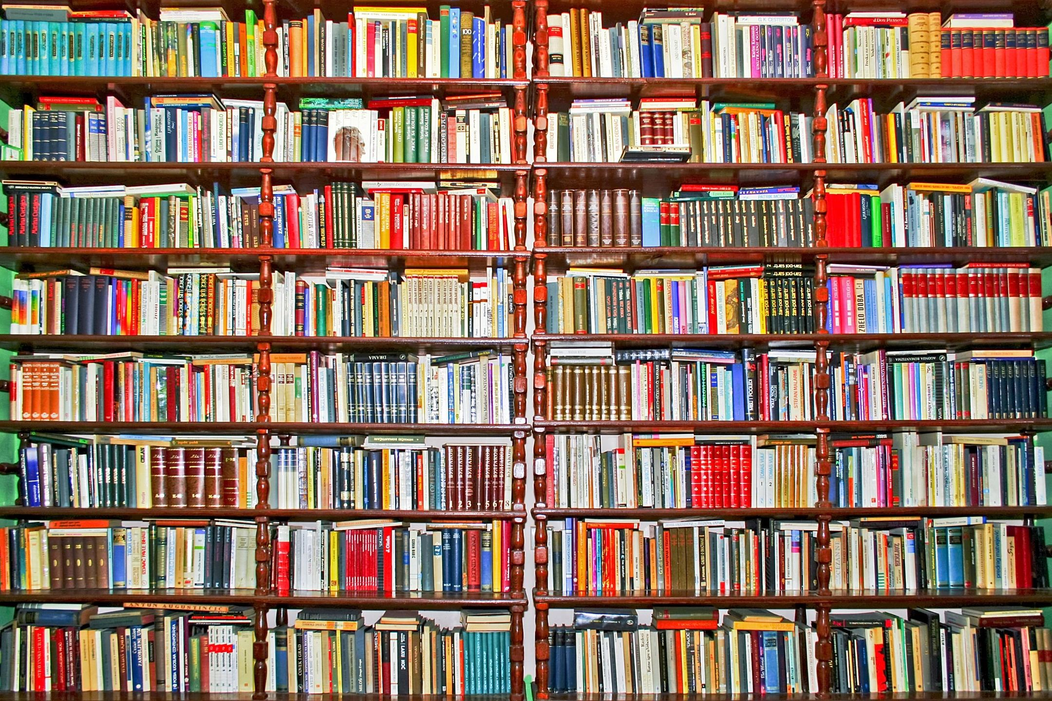 Book shelves jammed full with colorful books